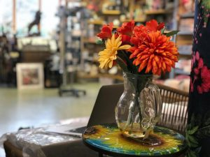 Vase with beautiful flowers in the giftware section